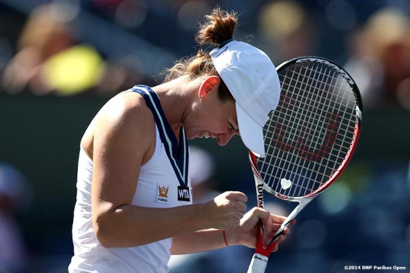 """""""Simona Halep reacts after defeating Casey Dellacqua at the 2014 BNP Paribas Open Wednesday, March 12, 2014 in Indian Wells, California."""""""
