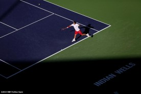 """""""Stan Wawrinka returns a shot from Kevin Anderson during the BNP Paribas Open Wednesday, March 12, 2014 in Indian Wells, California."""""""