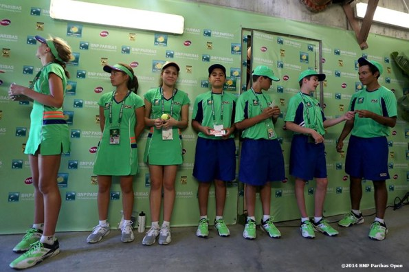 """""""Ball boys wait in the tunnel in Stadium One at the 2014 BNP Paribas Open Friday, March 14, 2014 in Indian Wells, California."""""""