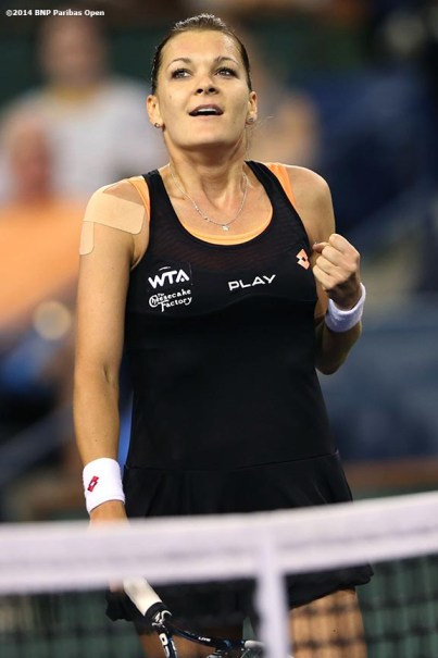 """""""Agnieszka Radwanska reacts after defeating Simona Halep in the semifinal of the 2014 BNP Paribas Open Friday, March 14, 2014 in Indian Wells, California."""""""