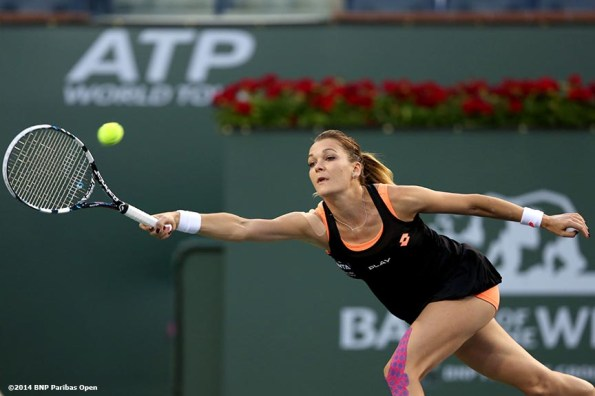 """""""Agnieszka Radwanska hits a forehand against Simona Halep in the semifinal of the 2014 BNP Paribas Open Friday, March 14, 2014 in Indian Wells, California."""""""