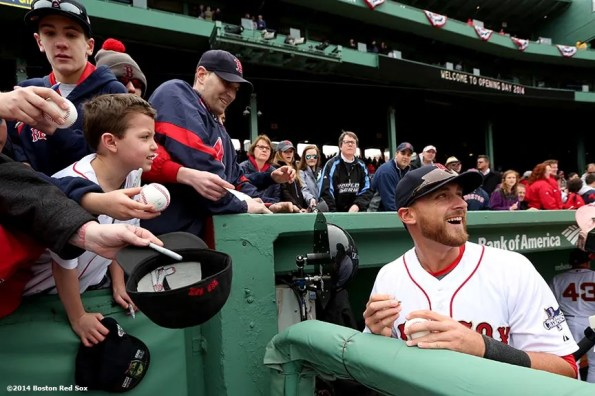 """""""Boston Red Sox third baseman Will Middlebrooks signs autographs during the World Series ring ceremony at the 2014 season home opener Friday, April 4, 2014 at Fenway Park in Boston, Massachusetts."""""""