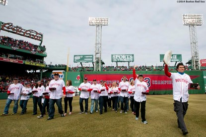 """""""Boston Marathon hero Carlos Arredondo and other victims, families, and heroes involved with the Boston Marathon bombings are introduced during the Boston Red Sox World Series ring ceremony at the 2014 season home opener Friday, April 4, 2014 at Fenway Park in Boston, Massachusetts."""""""
