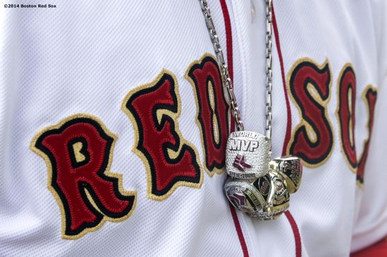 """""""Boston Red Sox designated hitter David Ortiz wears his 2004, 2007, and 2013 World Series rings and 2013 World Series Most Valuable Player ring on a necklace during the World Series ring ceremony at the 2014 season home opener Friday, April 4, 2014 at Fenway Park in Boston, Massachusetts."""""""