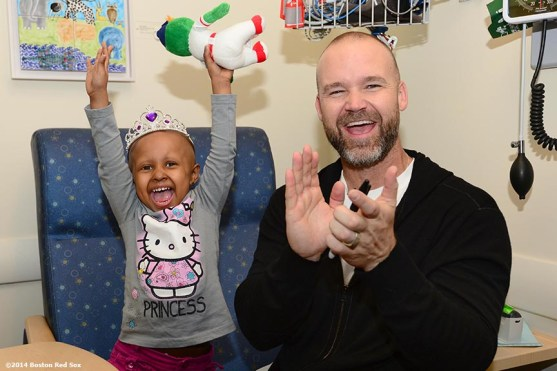 """""""Boston Red Sox catcher David Ross shares a laugh with Jimmy Fund patient Eliana Montas, 3, of Clinton, Massachusetts during a visit to the Jimmy Fund at the Dana-Farber Cancer Institute in Boston, Massachusetts Wednesday, May 21, 2014."""""""