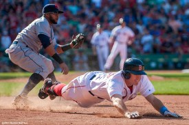 """""""Boston Red Sox third baseman Brock Holt dives through first base after attempting to beat out an infield hit during the ninth inning of a game against the Cleveland Indians at Fenway Park in Boston, Massachusetts Sunday, June 15, 2014."""""""