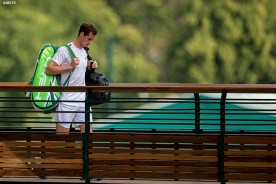 """""""Andy Murray walks across a bridge as he exits the grounds of the All England Lawn and Tennis Club after losing to Grigor Dimitrov in the quarter-finals Wednesday, July 2, 2014 during the 2014 Championships Wimbledon."""""""