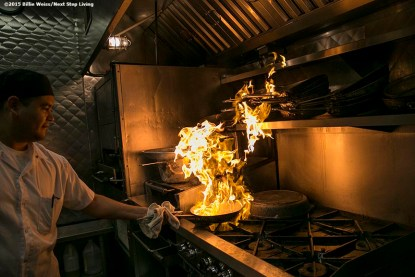 """""""A chef cooks as flames rise into a newly installed Eco Thermal Filter System in the kitchen of The Stockyard Steakhouse restaurant in Brighton, Massachusetts Tuesday, February 10, 2015."""""""