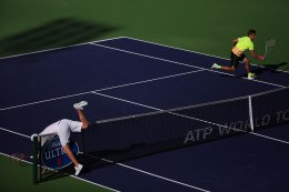 """""""Mardy Fish flips over the net during his match against Ryan Harrison inside Stadium 1 at the Indian Wells Tennis Garden in Indian Wells, California Tuesday, March 12, 2015."""""""