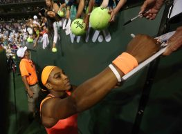 """""""Serena Williams signs autographs for fans following her win against Monica Niculescu during their match at Stadium 1 at the Indian Wells Tennis Garden in Indian Wells, California on Friday, March 13, 2015."""""""