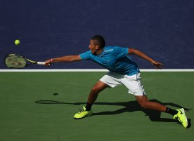 """""""Nick Kyrgios in action against Grigor Dimitrov during their match at stadium 1 at the Indian Wells Tennis Garden in Indian Wells, California on Sunday, March 15, 2015."""""""