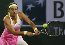 """""""Caroline Garcia in action against Sabine Lisicki during their match at stadium 1 at the Indian Wells Tennis Garden in Indian Wells, California on Tuesday, March 17, 2015."""""""