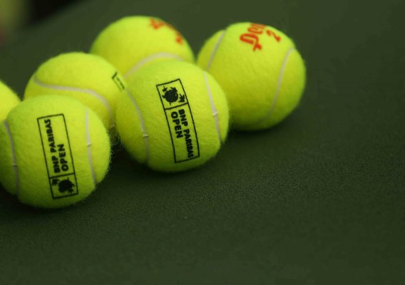 """""""A set of tennis balls sit on the court during the match between Rafael Nadal and Donald Young at stadium 1 at the Indian Wells Tennis Garden in Indian Wells, California on Tuesday, March 17, 2015."""""""