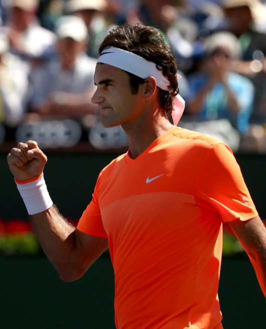 """""""Roger Federer reacts after defeating Tomas Berdych in a quarterfinal match on Stadium 1 at the 2015 BNP Paribas Open in Indian Wells, California on Friday, March 20, 2015."""""""