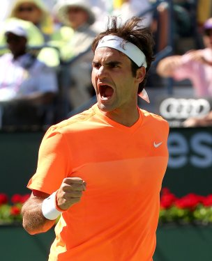 """""""A semifinal match between Roger Federer and Milos Raonic on Stadium 1 at the 2015 BNP Paribas Open in Indian Wells, California on Saturday, March 21, 2015."""""""