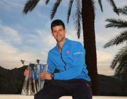 """""""Novak Djokovic poses with the Serbian flag following his victory in the Men's Singles Final of the 2015 BNP Paribas Open in Indian Wells, California on Sunday, March 22, 2015."""""""