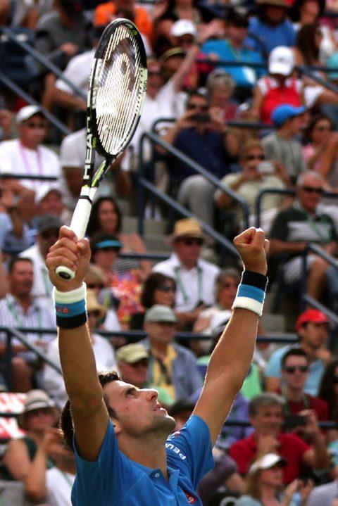 """Novak Djokovic reacts after winning the 2015 BNP Paribas Open Men's Singles Final against Roger Federer in Indian Wells, California on Sunday, March 22, 2015."""