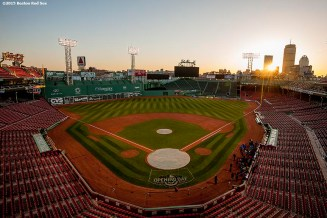 """""""The sun rises over Fenway Park in Boston, Massachusetts on home Opening Day of the 2015 season Monday, April 13, 2015."""""""