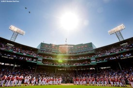 """""""A flyover is held as members of the Boston Red Sox and Washington Nationals line up alongside kids during a pre-game ceremony before the Boston Red Sox 2015 home opener against the Washington Nationals Monday, April 13, 2015 at Fenway Park in Boston, Massachusetts."""""""