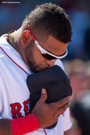 """""""Boston Red Sox third baseman Pablo Sandoval pauses for a moment of silence at 2:49 PM recognizing the anniversary of the Boston Marathon bombings during a game between the Boston Red Sox and the Washington Nationals at Fenway Park in Boston, Massachusetts Wednesday, April 15, 2015."""""""