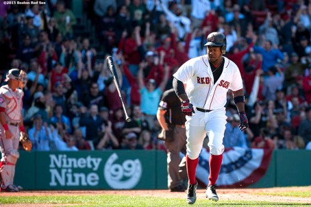 """""""Boston Red Sox left fielder Hanley Ramirez flips his bat after hitting a two run home run during the fifth inning of a game against the Washington Nationals at Fenway Park in Boston, Massachusetts Wednesday, April 15, 2015."""""""