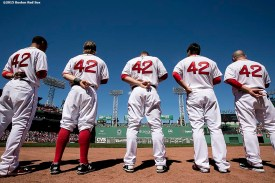 """""""Members of the Boston Red Sox wear #42 on their jerseys in honor of Jackie Robinson Day as they line up before a game against the Washington Nationals at Fenway Park in Boston, Massachusetts Wednesday, April 15, 2015."""""""