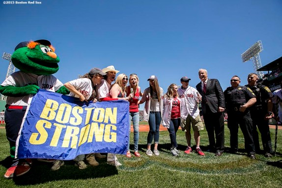 """""""Boston Marathon survivors announce 'Play Ball' before a game against the Washington Nationals at Fenway Park in Boston, Massachusetts Wednesday, April 15, 2015."""""""