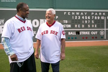 """""""Former Boston Red Sox left fielders Carl Yastrzemski and Jim Rice are introduced from behind the Green Monster scoreboard during a 1975 40 year reunion pre-game ceremony before a game between the Boston Red Sox and the Tampa Bay Rays at Fenway Park in Boston, Massachusetts Tuesday, May 5, 2015."""""""