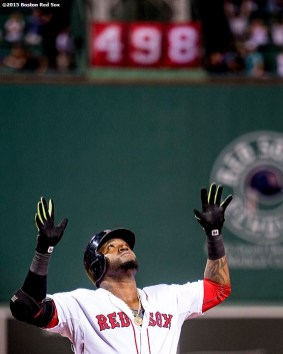 """""""Boston Red Sox designated hitter David Ortiz reacts after hitting a three run home run during the third inning of a game against the Toronto Blue Jays at Fenway Park in Boston, Massachusetts Monday, September 9, 2015. It was home run number 498 of his career. """""""