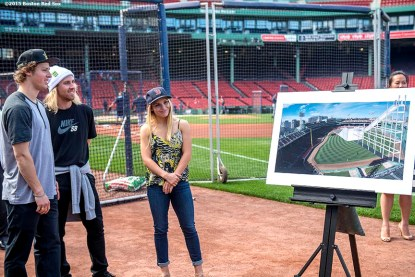 """""""Olympic skiing gold medalist Joss Christensen, Olympic snowboarding gold medalist Sage Kotsenburg, and snowboarder Ty Walker look on as a rendering is unveiled during a press conference announcing a Big Air ski and snowboard competition at Fenway Park in Boston, Massachusetts Tuesday, September 22, 2015."""""""