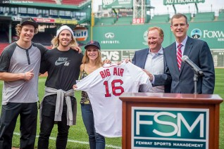 """""""Boston Red Sox Chief Operating Officer Sam Kennedy presents Olympic skiing gold medalist Joss Christensen, Olympic snowboarding gold medalist Sage Kotsenburg, snowboarder Ty Walker, and USSA CMO Michael Jaquet with a jersey during a press conference announcing a Big Air ski and snowboard competition at Fenway Park in Boston, Massachusetts Tuesday, September 22, 2015."""""""
