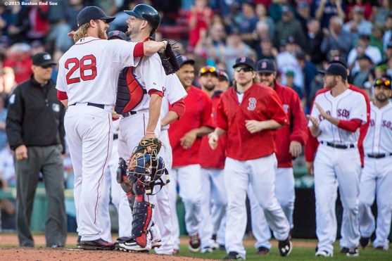 """""""Boston Red Sox pitcher Robbie Ross Jr. and catcher Blake Swihart hug after defeating the Baltimore Orioles at Fenway Park in Boston, Massachusetts Sunday, September 27, 2015."""""""