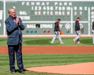 """""""Boston Red Sox President & CEO Larry Lucchino reacts before throwing out a ceremonial first pitch during a tribute ceremony for him before a game between the Boston Red Sox and the Baltimore Orioles at Fenway Park in Boston, Massachusetts Sunday, September 27, 2015."""""""