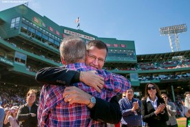 """""""Boston Red Sox President & CEO Larry Lucchino is congratulated by Chief Operating Officer Sam Kennedy during a tribute ceremony for Larry Lucchino before a game between the Boston Red Sox and the Baltimore Orioles at Fenway Park in Boston, Massachusetts Sunday, September 27, 2015."""""""
