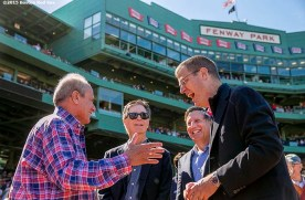 """""""Boston Red Sox President & CEO Larry Lucchino, Principal Owner John Henry, Chairman Tom Werner, and Chief Operating Officer Sam Kennedy talk during a tribute ceremony for Larry Lucchino before a game between the Boston Red Sox and the Baltimore Orioles at Fenway Park in Boston, Massachusetts Sunday, September 27, 2015."""""""