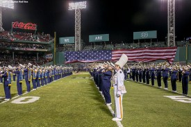 """""""The American flag is dropped over the Green Monster as the Notre Dame marching band performs during the Shamrock Series Football at Fenway game against Boston College at Fenway Park in Boston, Massachusetts Saturday, November 21, 2015."""""""