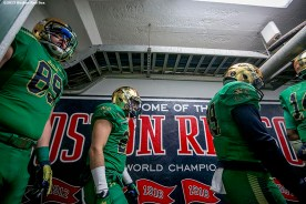 """""""Members of Notre Dame walk through the tunnel during the Shamrock Series Football at Fenway game against Boston College at Fenway Park in Boston, Massachusetts Saturday, November 21, 2015."""""""