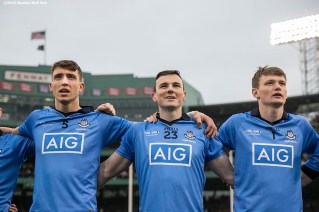 """""""Members of Dublin look on during the National Anthem before playing Galway at the AIG Hurling Classic and Irish Festival at Fenway Park in Boston, Massachusetts Saturday, November 22, 2015."""""""