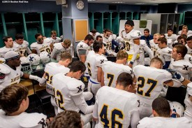 """""""Members of the Xaverian Brothers High School football team sit in the locker room before a game against St. John's Preparatory School at Fenway Park in Boston, Massachusetts Wednesday, November 25, 2015."""""""
