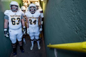 """""""Members of the Xaverian Brothers High School football team wait in the tunnel before a game against St. John's Preparatory School at Fenway Park in Boston, Massachusetts Wednesday, November 25, 2015."""""""