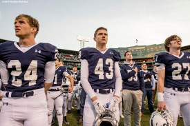"""""""Members of the St. John's Preparatory School football team look on before a game against Xaverian Brothers High School at Fenway Park in Boston, Massachusetts Wednesday, November 25, 2015."""""""