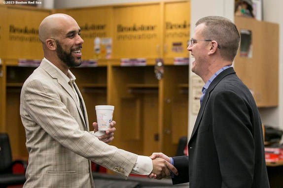 """""""Boston Red Sox President Sam Kennedy greets pitcher David Press in the clubhouse before a press conference announcing a seven year contract to the Boston Red Sox at Fenway Park in Boston, Massachusetts Friday, December 4, 2015."""""""
