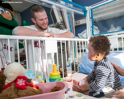 """""""Boston Red Sox pitcher Craig Kimbrel visits a patient at Shriner's Hospital during the Holiday Caravan in Boston, Massachusetts Friday, December 11, 2015."""""""