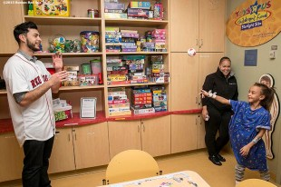 """""""Boston Red Sox pitcher Noe Ramirez plays catch with a patient at Massachusetts General Hospital during the Holiday Caravan in Boston, Massachusetts Friday, December 10, 2015."""""""