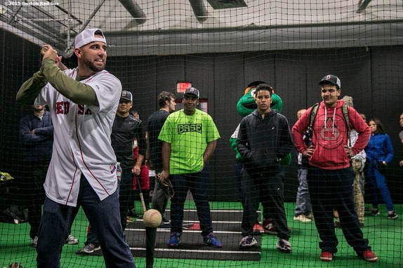 """""""Boston Red Sox infielder Deven Marrero takes swings in the cage as kids watch at the Base during the Holiday Caravan in Boston, Massachusetts Friday, December 10, 2015."""""""