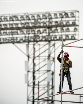 """""""A worker builds scaffolding as construction continues on the Polartec Big Air at Fenway ski and snowboard ramp at Fenway Park in Boston, Massachusetts Tuesday, January 26, 2016."""""""