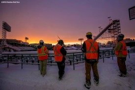 """""""Workers look on while the sun sets as construction continues on the Polartec Big Air ski and snowboard ramp at Fenway Park in Boston, Massachusetts Friday, February 5, 2016."""""""