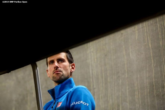 """""""Novak Djokovic warms up in the tunnel before a match against Bjorn Fratangelo during the 2016 BNP Paribas Open at the Indian Wells Tennis Garden in Indian Wells, California Sunday, March 13, 2016."""""""