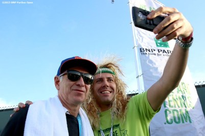 """""""John McEnroe greets guests at the We Are Tennis BNP Paribas Fan Academy at the Tennis Warehouse Demo Court during the 2016 BNP Paribas Open at the Indian Wells Tennis Garden in Indian Wells, California Sunday, March 13, 2016."""""""