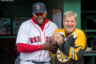 BOSTON, MA - APRIL 11: David Ortiz #34 of the Boston Red Sox and former Boston Bruins player Bobby Orr react before throwing a ceremonial first pitch during the home opener against the Baltimore Orioles on April 11, 2016 at Fenway Park in Boston, Massachusetts . (Photo by Billie Weiss/Boston Red Sox/Getty Images) *** Local Caption *** David Ortiz; Bobby Orr